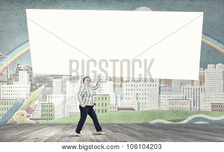Stout woman of middle age carrying blank white banner