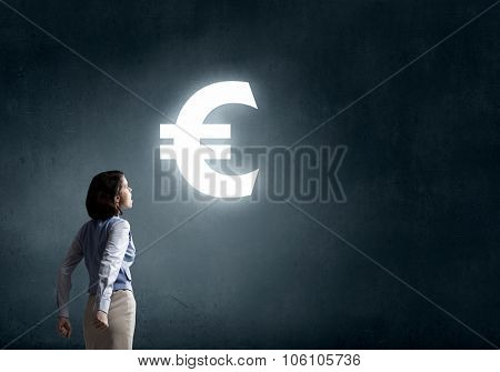 Young businesswoman making fists and screaming up in despair