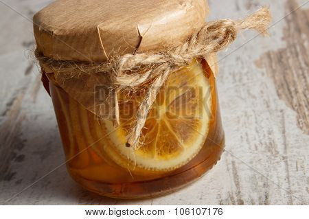 Lemon With Honey In Glass Jar On Wooden Table, Healthy Nutrition