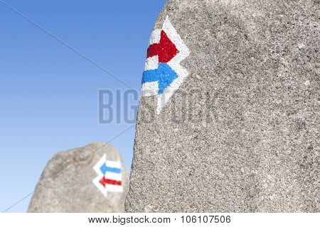 Trail Signs Painted On Rock, Choice Or Dilemma Concept.