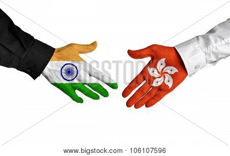 India and Hong Kong leaders shaking hands on a deal agreement