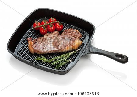 Sirloin steak with rosemary and cherry tomatoes cooking in a frying pan. Isolated on white background