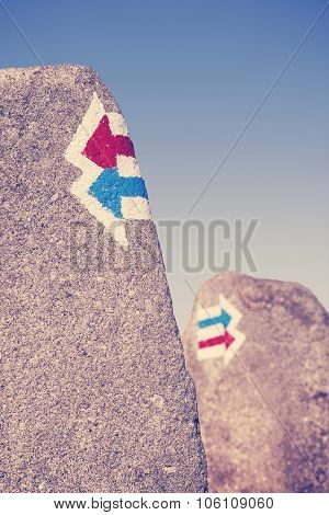 Retro Toned Trail Signs Painted On Rock, Choice Or Dilemma Concept