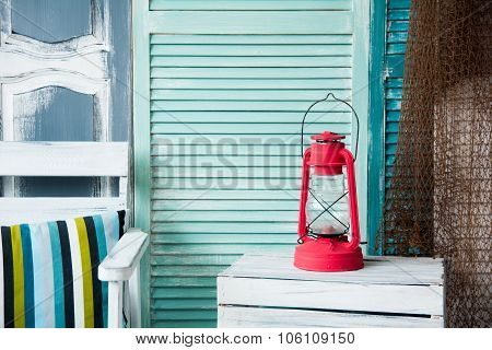 Vintage Red Kerosene Lamp On The Background Of The Old Painted Wall