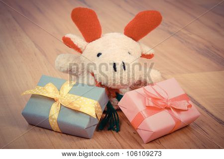 Vintage Photo, Plush Reindeer With Colorful Gifts For Christmas Or Other Celebration