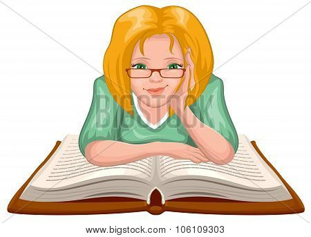 Woman reading book. Young woman in glasses placed his hands on an open book