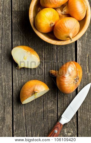 halved fresh onion on wooden old table