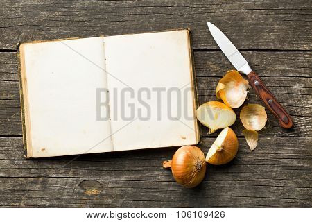 blank recipe book and halved onion