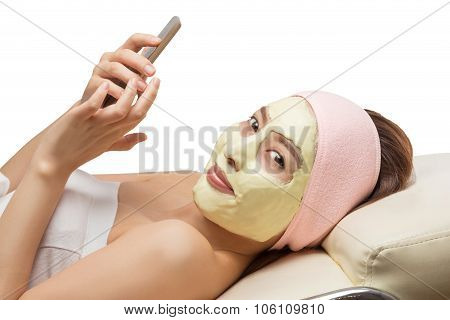 Portrait of young woman getting a beauty treatment