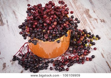 Bunch Of Fresh Elderberry On Old Wooden Background, Healthy Food