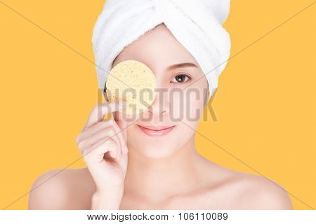 young smiling woman cleaning her face