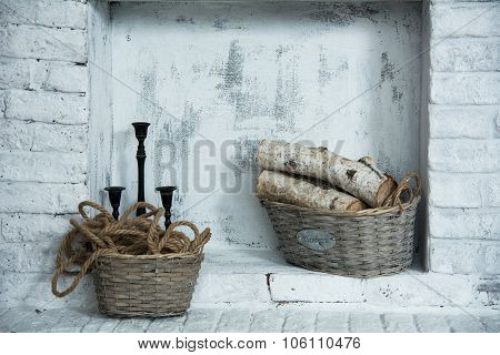 Background Light Niches In Masonry With Baskets Of Firewood, A Rope And A Candlestick