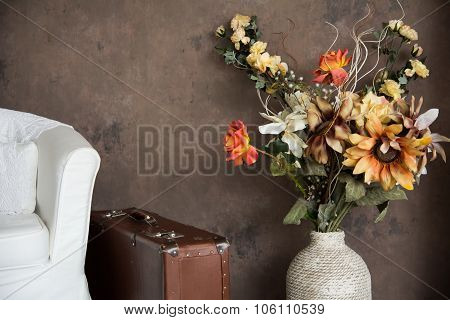 Design Vintage Interior With Flowers In A Vase Suitcases And Chairs