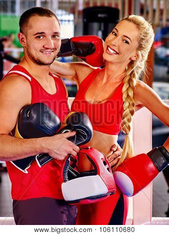 Female boxer with your male coach after workout in gym