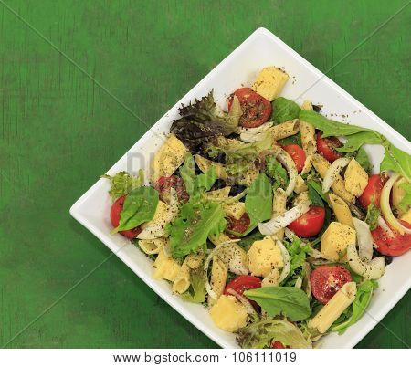 Colourful Organic Salads in a White Square Bowl