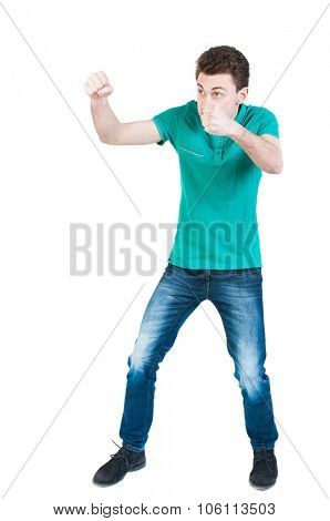 skinny guy funny fights waving his arms and legs. Isolated over white background. Funny guy clumsily boxing. A young boy learns to box.