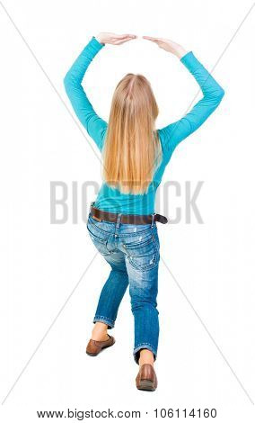 back view of woman  protects hands from what is falling from above. woMan holding a heavy load Rear view people collection.  backside view of person.  Isolated over white background.