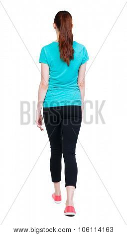 side view of walking  woman in sports tights. beautiful girl in motion.  backside view of person.  Rear view people collection. Isolated over white background.  Sport girl in black tights out ahead.