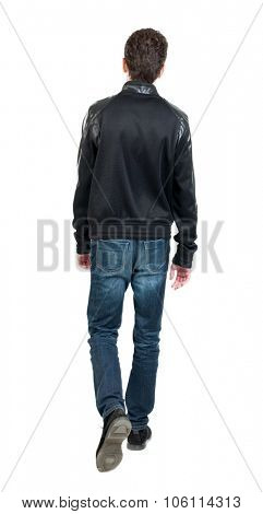 Back view of going  handsome man in jacket.  walking young guy . Rear view people collection.  backside view of person.  Isolated over white background.  The guy is holding up the leg.