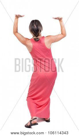 back view of woman  protects hands from what is falling from above.Rear view people collection.  backside view of person.  Isolated over white background.