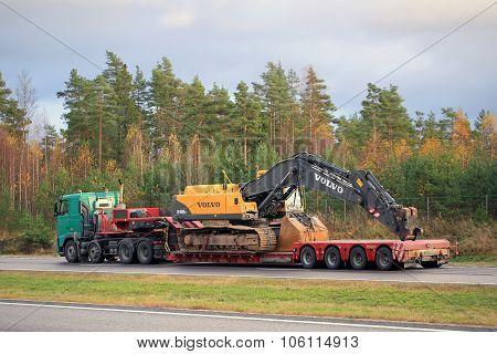 Volvo Truck Hauls Volvo Hydraulic Crawler Excavator