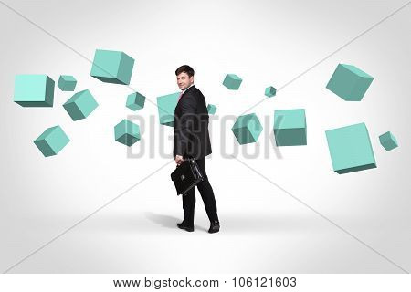 Business man near with turquoise cubes