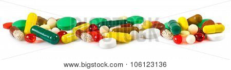 Different Pills On White Background