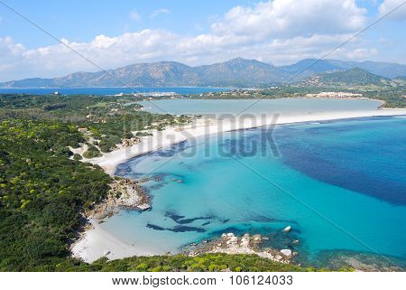 View Of A Piece Of Colorful Nature In Villasimius (sardinia) With Lake, Sea Mountain And Cloudy Sky.