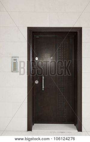 Residential Building Wall With Iron Door And Intercom System