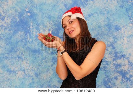 Woman with christmas candle