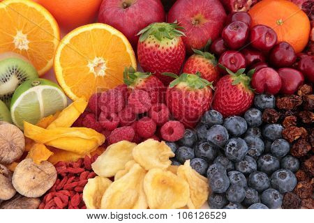Fruit superfood background with fruits high in antioxidants, vitamin c and dietary fibre.