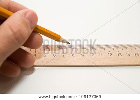 Men's Left Hand Holding A Pencil On Over White
