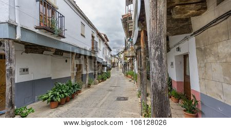 Guadalupe vintage streets with wooden columns in Spain
