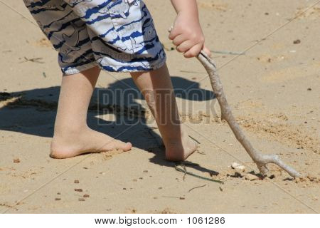 Young Boy Playing On Beach