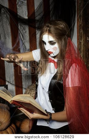Witch Casts A Spell Over Magic Book