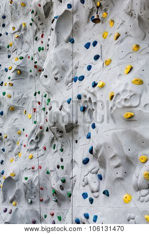 Colorful Hand And Foot Holds On Climbing Wall