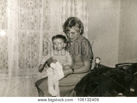 LODZ, POLAND, CIRCA 1981: Vintage photo of grandaunt and a little boy