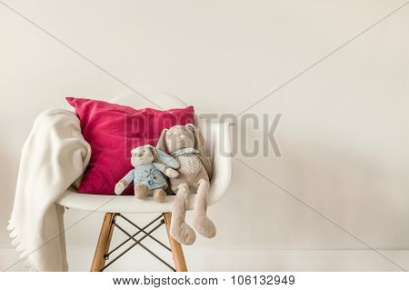 Infant Accessories On White Chair