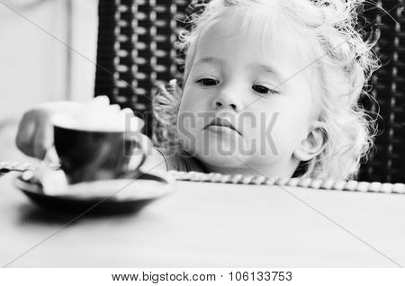 Toddler Girl In Cafe