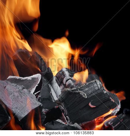 Charcoal Glowing With Flames Of Fire Isolated On Black