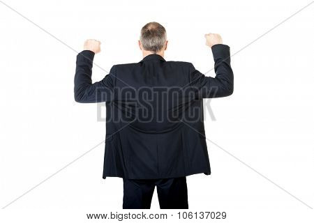 Back view successful businessman with arms up.