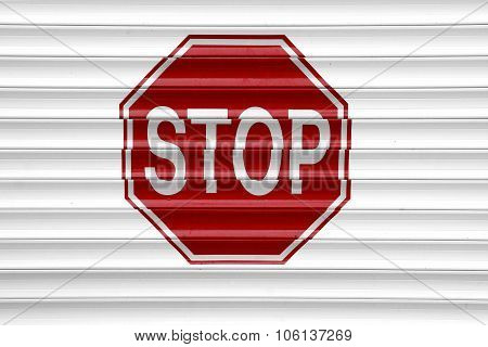 Stop Sign On The Automatic  Aluminum Garage Gate