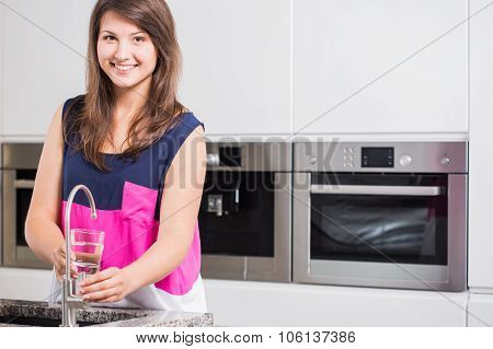 Young Woman Pouring Tap Water