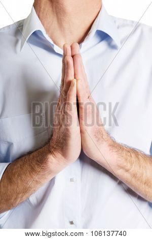 Mature male hands clenched to pray.