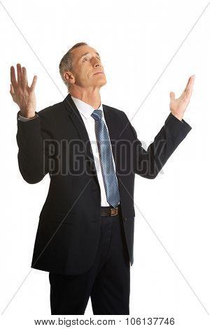 Businessman with hands open gesture.