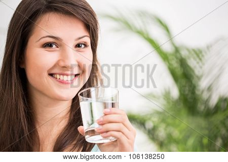 Fit Girl Drinking Mineral Water