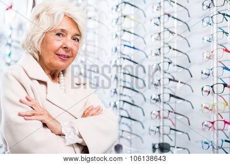 Elder Woman In Optician Store