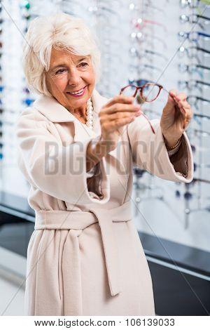 Female Retiree Choosing New Spectacles