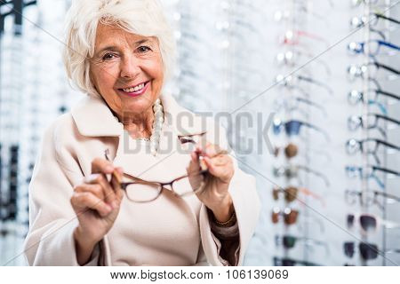 Female Retiree In Optician Store