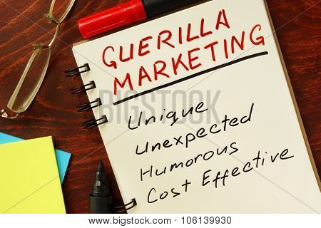 Notepad with guerilla marketing concept.